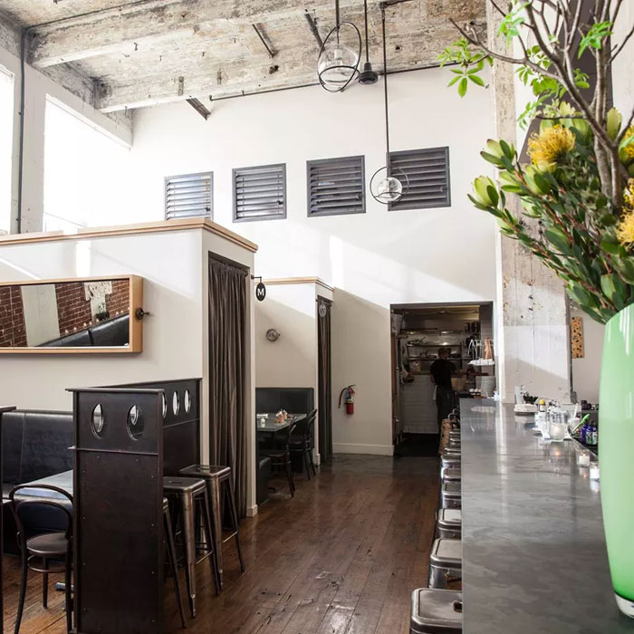 Where to Eat & Drink in Dogpatch - Industrial spaces with high ceilings, exposed brick, and lots of concrete can sometimes feel cold, but Serpentine has so much warmth thanks to its cozy booths and friendly service, one would never even think it used to be the boiler room for a factory that manufactured tin cans.