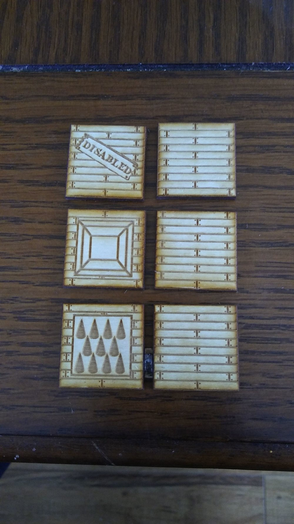 Trap Token Set of 3 – Advanced Deployment  It's a trap! Now you can show your players and mark on your battlemats where deadly traps have been discovered. Spiked pits, open pits, and disabled traps are all easily marked. Disable them or let the barbarian figure out what rogues are for.