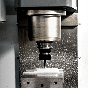 CNC MILLING MACHINE - This electronically operated machine can perform a vast number of complex operations, such as slot and keyway cutting, planing, drilling, die sinking, rebating, routing, plus many more functions.