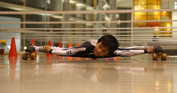An example of limbo-skating. This is Tiluck Keisam, a world-record holder in his own right.  Source:  http://www.guinnessworldrecords.com/Images/Tiluck-Keisam-2015-attempt_tcm25-470092.jpg