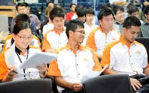 Bunja Racing Team from The Otomotif College listening intensely at the Bosch Power Tools Asia Cordless Race 2011 Racers Briefing  Image source:  homefinder