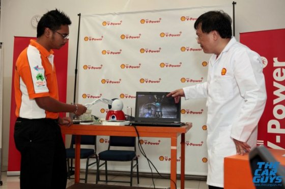Mr. Loke advising the student on operating the thingamajig. The laptop gives out a simulated explosion and sound effects too!  Image from:  thecarguys.my