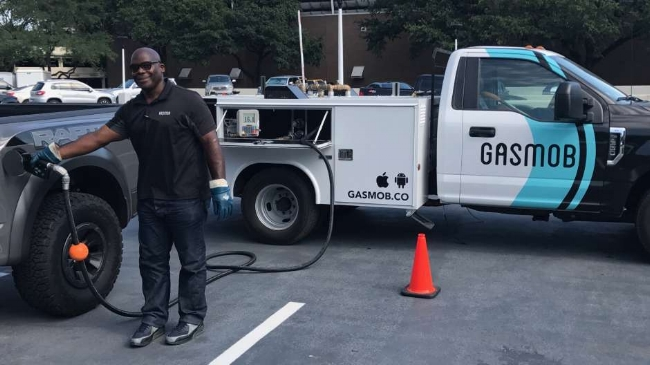 GasMob worker is refuelling a Ford Raptor?!!  Image from:  Houston Chronicle