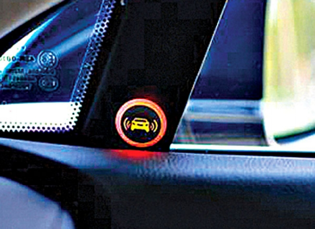 Blindspot warning light turn on when a car or bike is approaching or getting near from behind or side of the car.    Source  |  Image: www.consumerreports.org