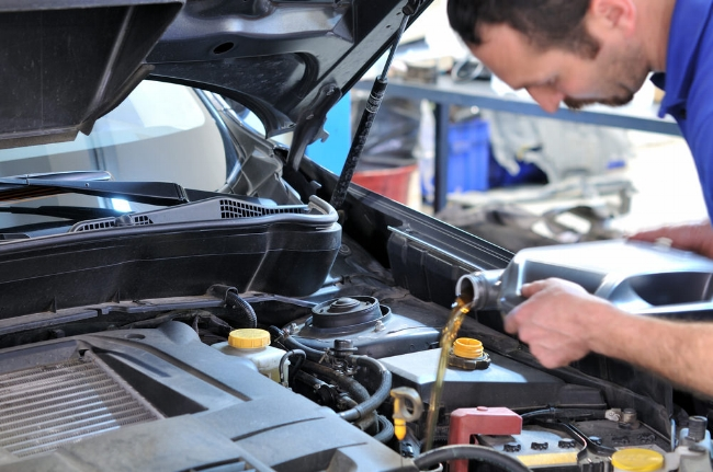 Picture shown mechanic pouring lubrication oil into engine system.  Image from:  Your Mechanic