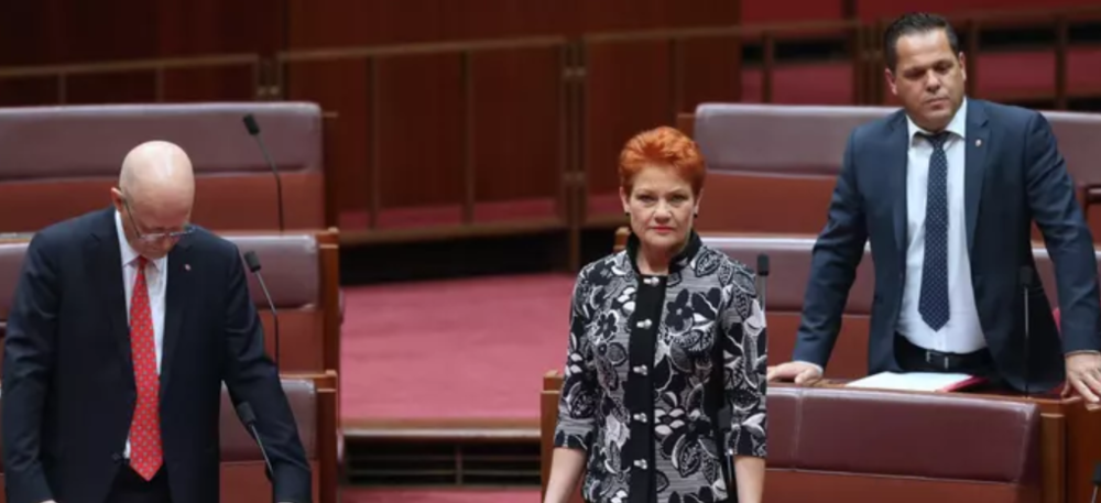 Far-right One Nation member Pauline Hanson reading her divisive 'it's ok to be right' motion in Parliament