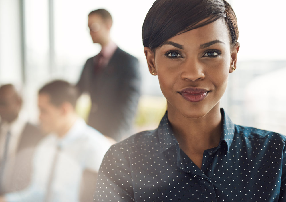 Confident-business-woman-in-office-with-group-530417408_3755x2656.jpeg