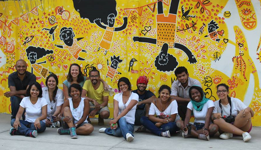 Four design professors, five students, and two local artists. People with different mindsets, ages and interests. What you can't see in this picture, is that it was taken inside a school located in Zapatero, a high-poverty neighborhood in Cartagena, Colombia. We spent around ten hours drawing and painting the mural for the children attending this school. Our idea was to help the kids from the Fernando de la Vega school to see the positive in the world, knowing the complicated struggles these kids go through in a regular basis.