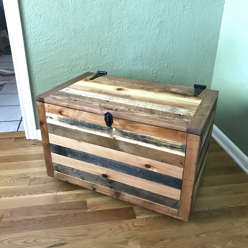 Reclaimed wood chest on casters.