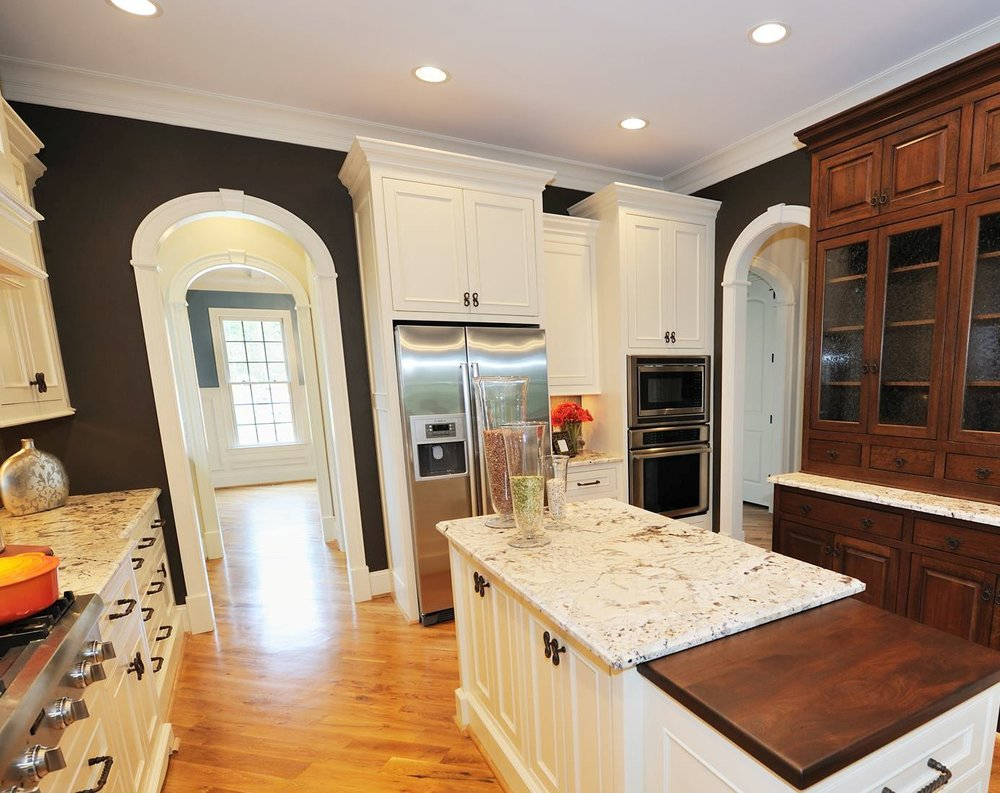 arch trim details in kitchen, butler pantry, and dining room. ez arch style with 470 casing profile.