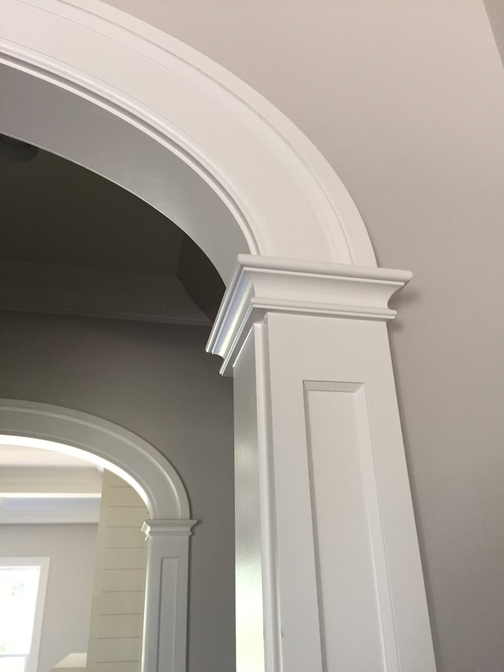 """farmhouse style arched opening - frame and flat panel column detail - 5"""" wide casing detail"""