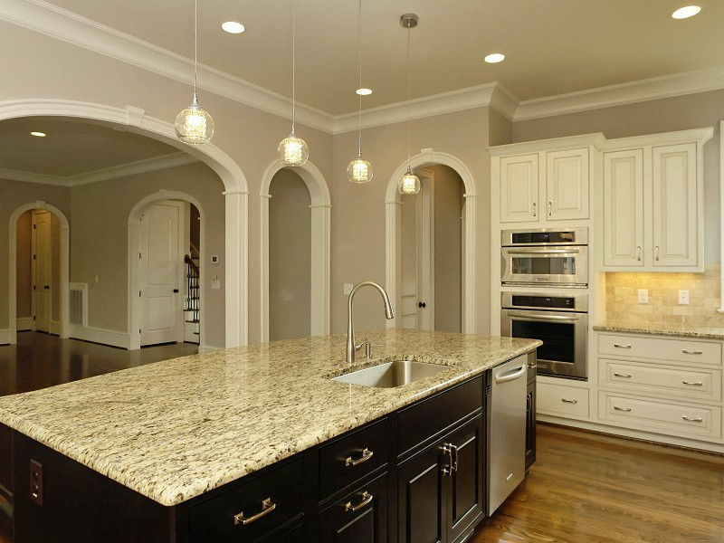 interior archways in open kitchen - family room layout