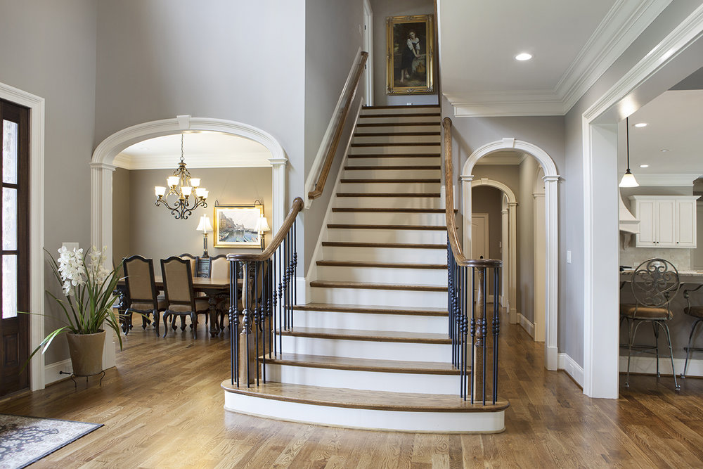Interior Archway Trim Products in a grand foyer. Elliptical Style Arches with keystones, capitals, and Plinth blocks.