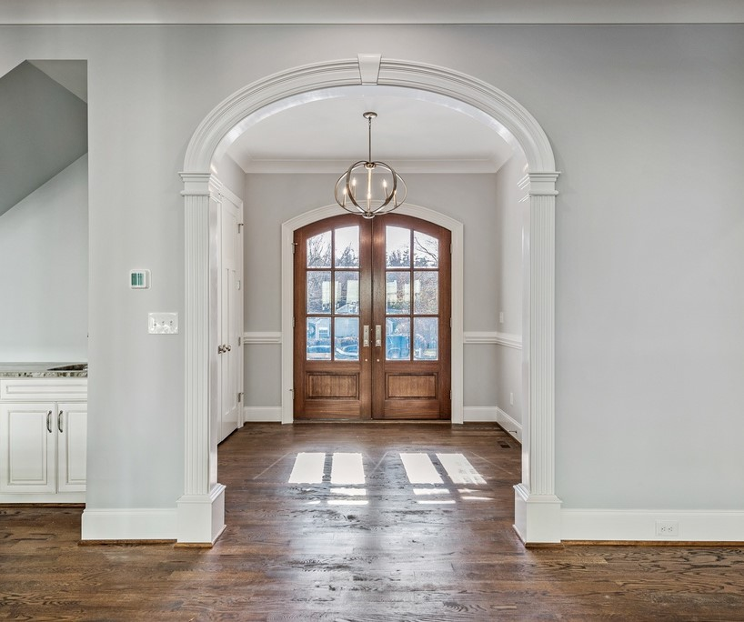 Elliptical Foyer Arched Opening in modern farmhouse setting. Six foot wide arched opening. Model A style.