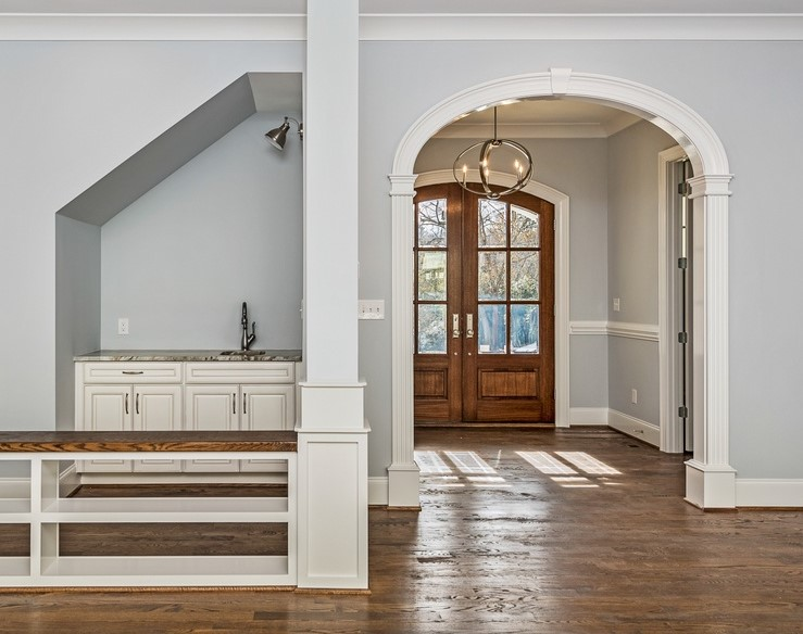 Arched Opening, Model A style in foyer. Solid Wood Archway Trim Kit.