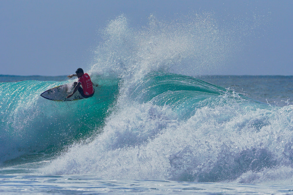 Piso Alcala, Philippines # 2, riding the lip in his quarterfinal heat against PJ Alipayo.
