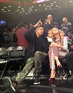 Jay Z and Beyonce enjoying the game in VIP chairs.