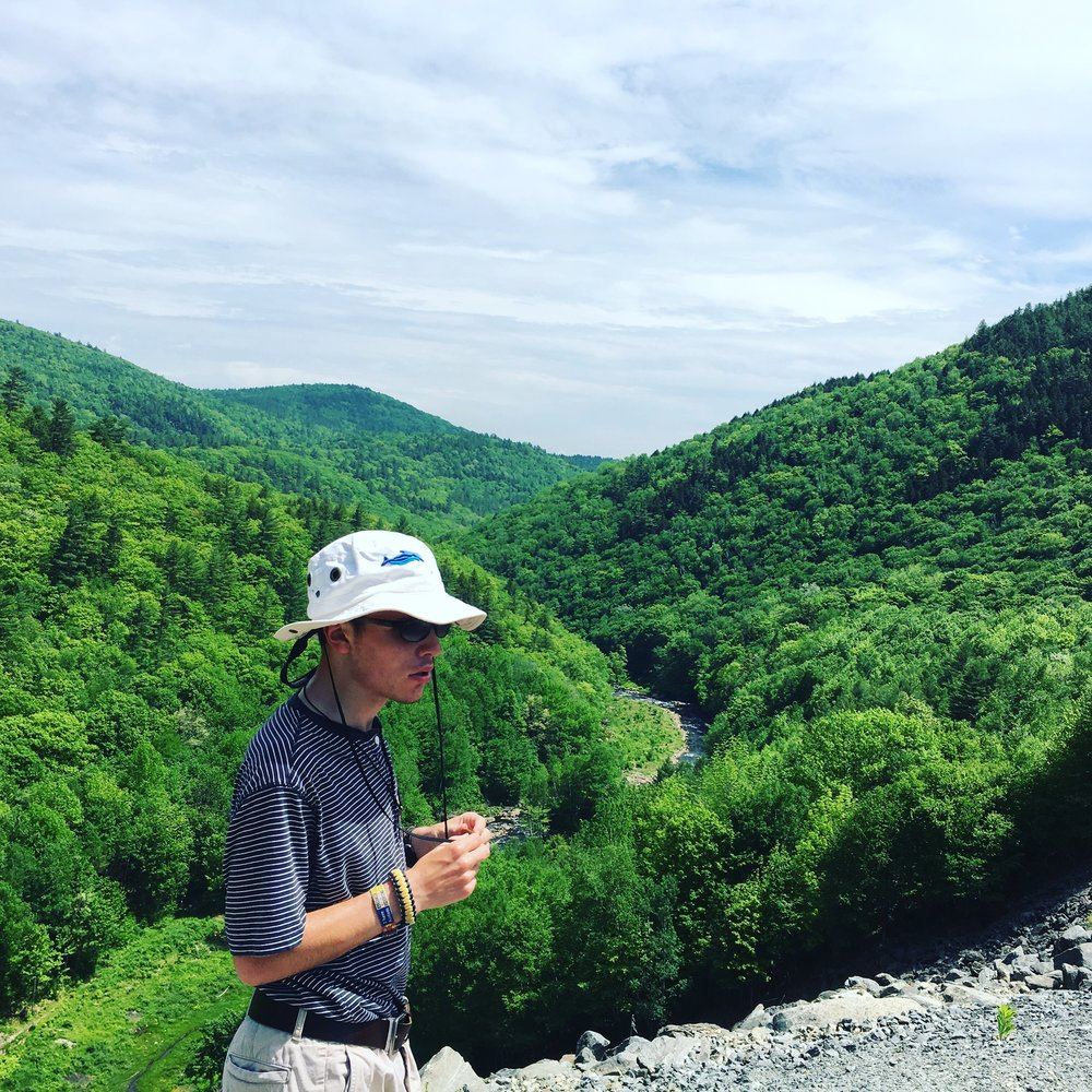 Dustin Sweeney hiking on The Long Trail in Vermont