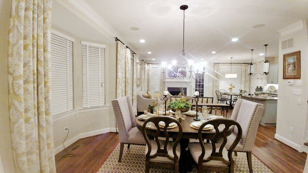 Custom white window blinds throughout dining room and kitchen by 3rdGenBlinds