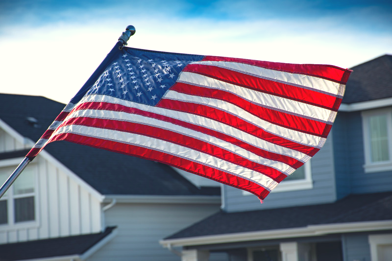 American flag in front of house.png