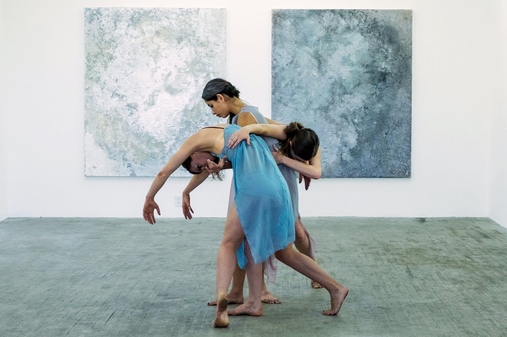 A moment from Multitudes in B Major, choreographed by Thea Bautista (center) + performed with Sarah LeGuenno (left)+ Catherine Walsh (right). Image courtesy of Prelude Projects.
