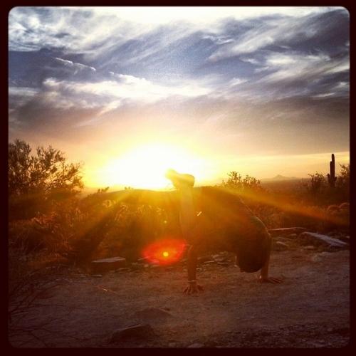 Yoga arm balance after a sunset hike in Arizona