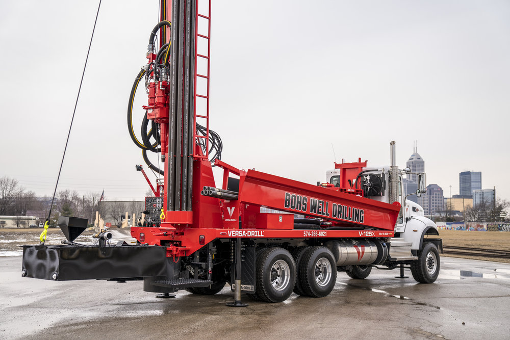 A new V-125 water well drilling rig, freshly painted and ready for the road