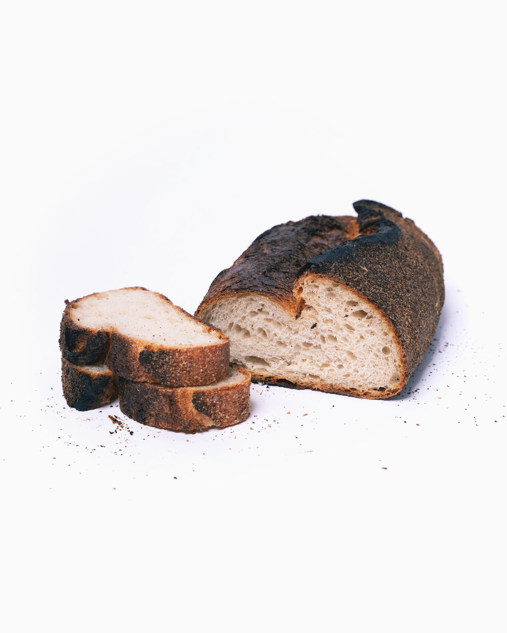 Pane da Tavola   Rustic Italian-style, charred crust with notes of coffee and cacao. Modeled after the famous bread of Genzano, Italy. (v)  Organic bread flour, spelt^, malted barley*, salt, water, yeast