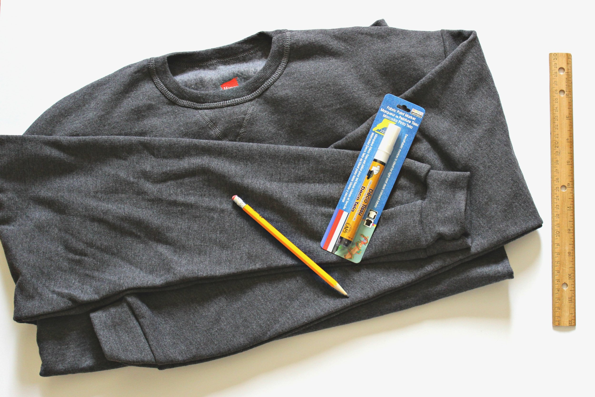 How To Make Your Own Graphic Sweatshirt // all together this project costs $12 and takes about 15 minutes!