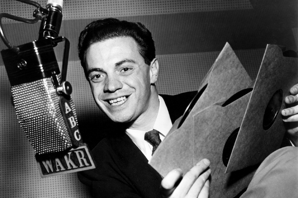 "Radio DJ Alan Freed is widely credited with using the phrase ""rock 'n' roll"" to describe his mix of music."