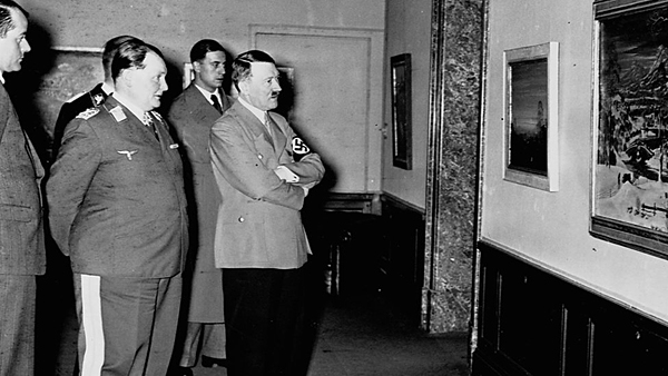 """Adolph Hitler at the exhibition of """"degenerate art""""."""