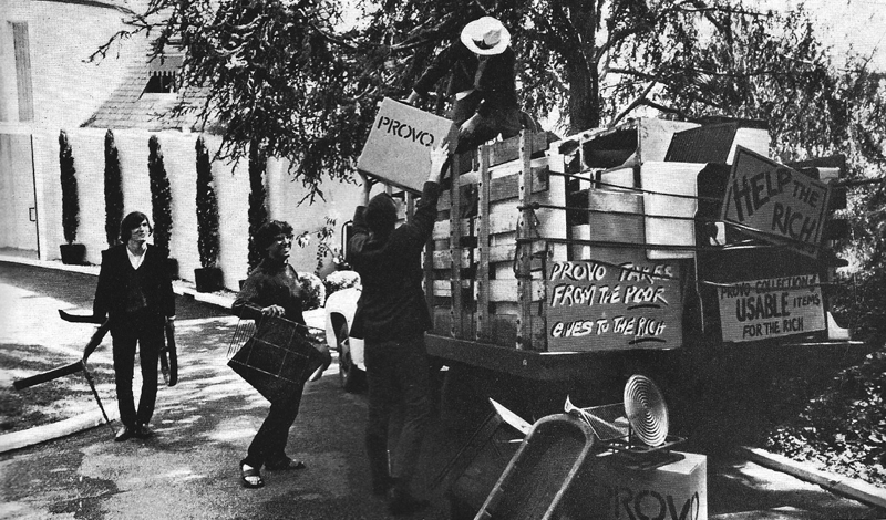 LA Provos Joseph Byrd, Peter Leaf, Michael Agnello and Dan Kabalevsky distributing household articles collected in the lower income district of Watts to the rather more prosperous residents of Beverly Hills and Hollywood.