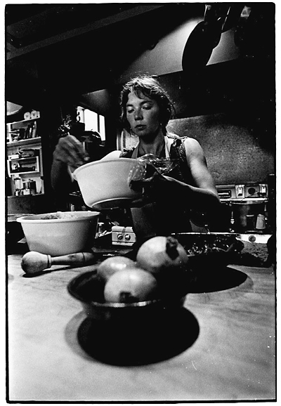 Diane LaRue preparing a dish for dinner at the Diamond Sutra.
