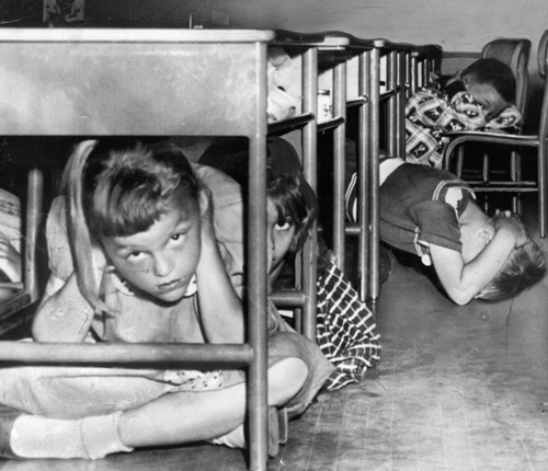 """""""Duck and Cover"""" drills in preparation for nuclear war were common for American school children of the mid-fifties."""