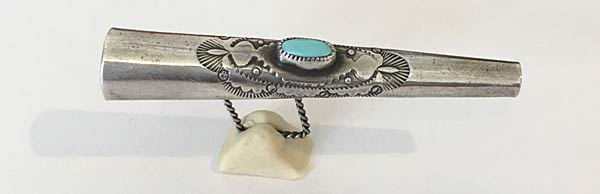"""a tiny silver horn, set with a turquoise piece"" found among objects in a  von Meier Treasure Box"