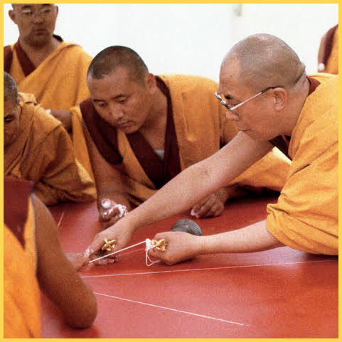 H.H. the Dalai Lama lays a mandala chalk line, evenly, level and unconfused