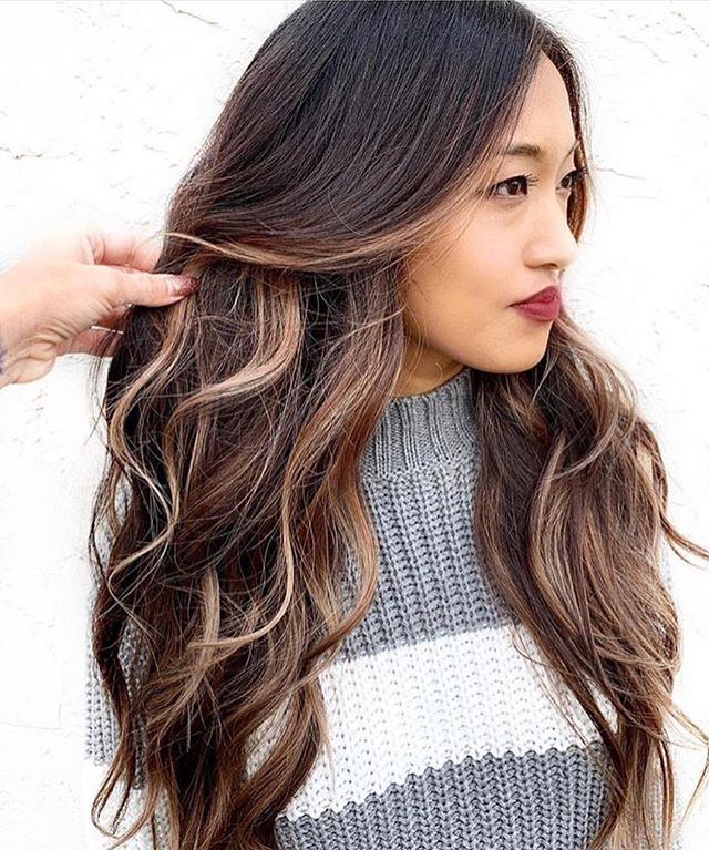 Caramel highlights add depth and dimension to dark hair. Repost @bestofbalayage @mdjhair