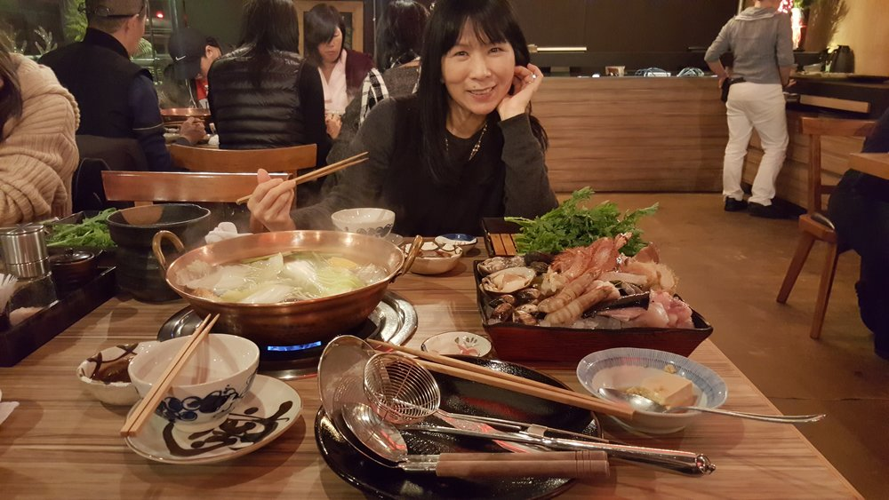 my adorable mother about to feast on hotpot at addiction aquatic development!
