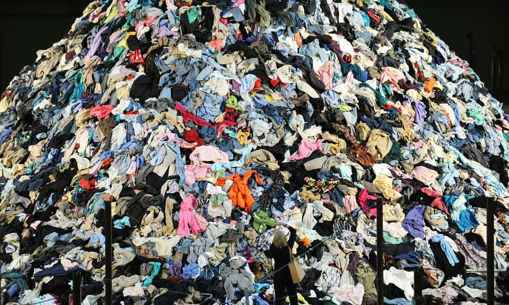 French artist Christain Boltanski's 'No Man's Land', was made of 30 tons of discarded clothing. Britain alone is expected to send 235m items of clothing to landfill this spring. Photograph: Stan Honda/AFP/Getty Images