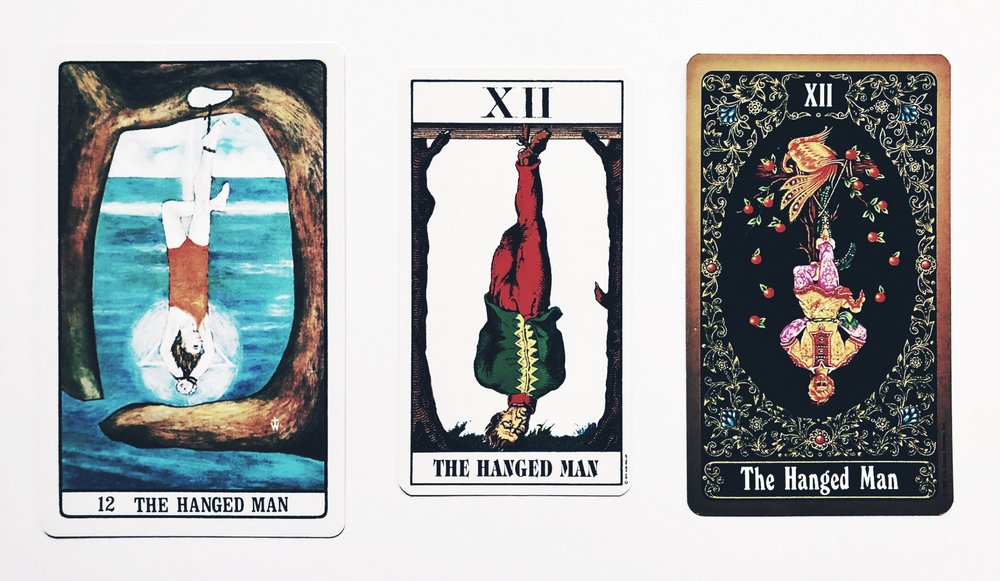 The Hanged Man from  The Golden Dawn Tarot ,  1JJ Swiss Tarot , and  Russian Tarot of St. Petersburg