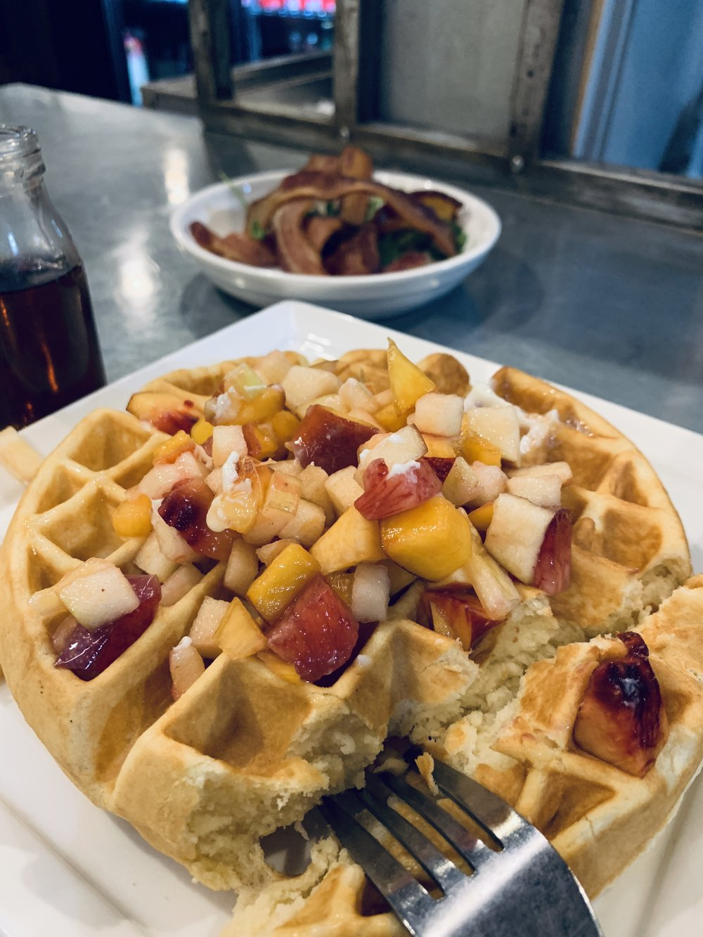 Left:   Waffle - buttermilk batter waffle, diced fruit, whipped butter, warm syrup $11  Side: Bacon $6.00  Drink: Orange Juice