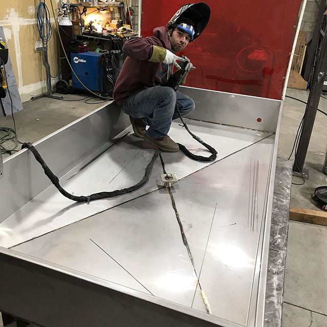Ninja tank fabricator Matt Striebeck hard at work on a 7 bbl coolship.