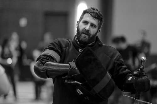 Jason Barrons - LOVES:German Renaissance Longsword, Sword and Buckler, Single Stick, cutting with sharps, playing with scissors, training new fencers.Jason is the president of The HEMA Alliance, and editor-in-chief of Measure and Weigh, a HEMA product review website.Jason has won Gold at Study in Steel 2017, Silver in both the open steel longsword and team event at PHO 2017, as well as bronze in the 100 fencer tier b steel longsword tournament at Longpoint 2017. He is currently ranked 40th in the USA & 107th in the world for Longsword, and ranked as high as 80th in Sword and Buckler.