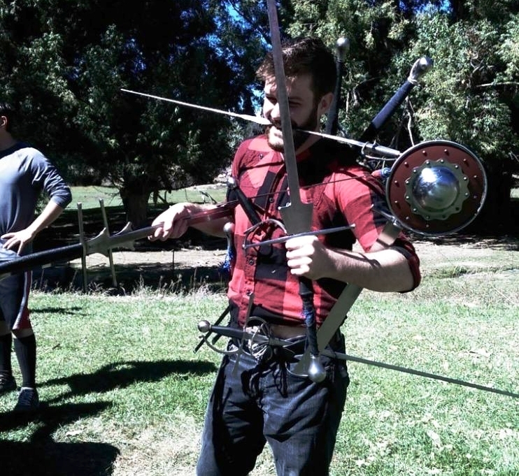 Sam Beardsley - LOVES: German Longsword, Rapier & Dagger, Single Rapier, Messer, being fucking weird.The resident left handed instructor, Sam is an expert at helping you discover what openings are exposed and you don't realize it.Recently Sam came  in 3rd in single rapier at RMK2017, Silver in the basic cutting tournament at Longpoint, and is ranked 69th in the world for rapier and dagger.
