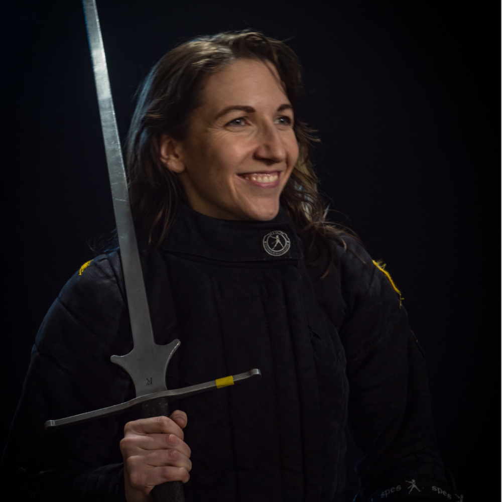 Meghan o'connell - LOVES: Medieval German Longsword, introducing folks to fencing, snazzy sparring socks, the utility of panniers.Meghan comes to Denver from New York City, where she trained at the renowned NYHFA school with some of the best instructors and fencers in the world. She brings an excellent knowledge of early german longsword, and how to whoop the ass of anyone of any size. Meghan is ranked 68th in the world in women's longsword.