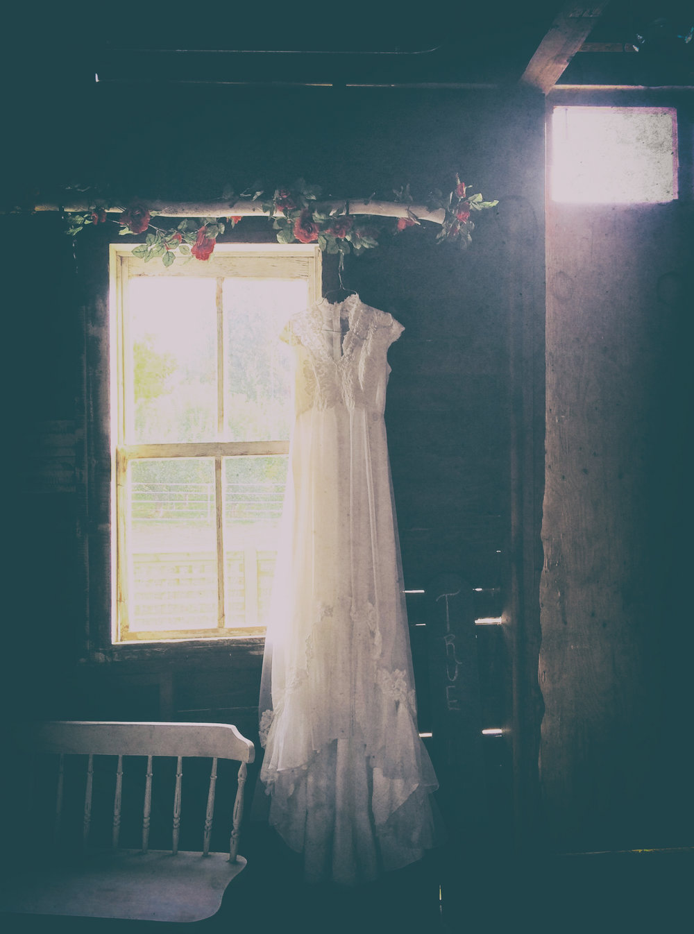 wedding-dress-hanging-in-barn-fx.jpg