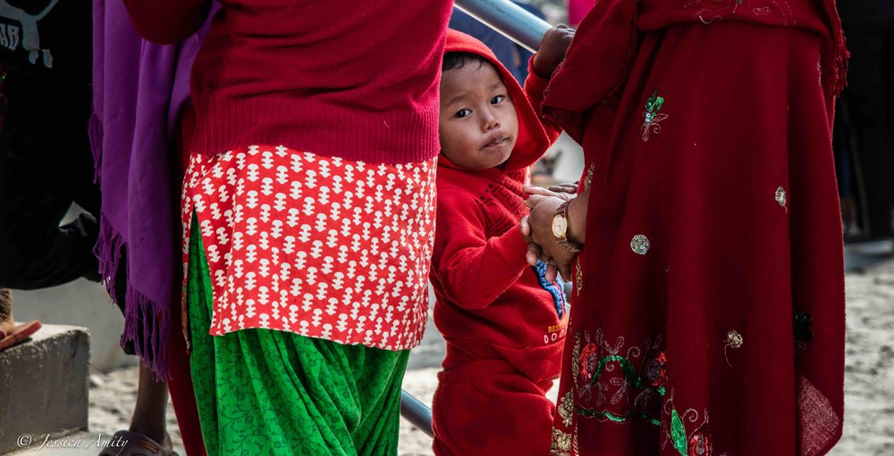 Children are among the many waiting in line at the opening of the medical camp.