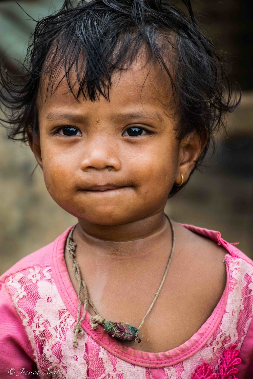 A little girl (age 2). In traditional Nepalese culture, piercings (the nose actually holds more significance), are usually done before a girl turns 5 and carries different meanings among different castes. For example, Brahmins and Chhetris believe wearing such ornaments portray a woman's purity and are believed to protect a woman and her family from evil spirits.