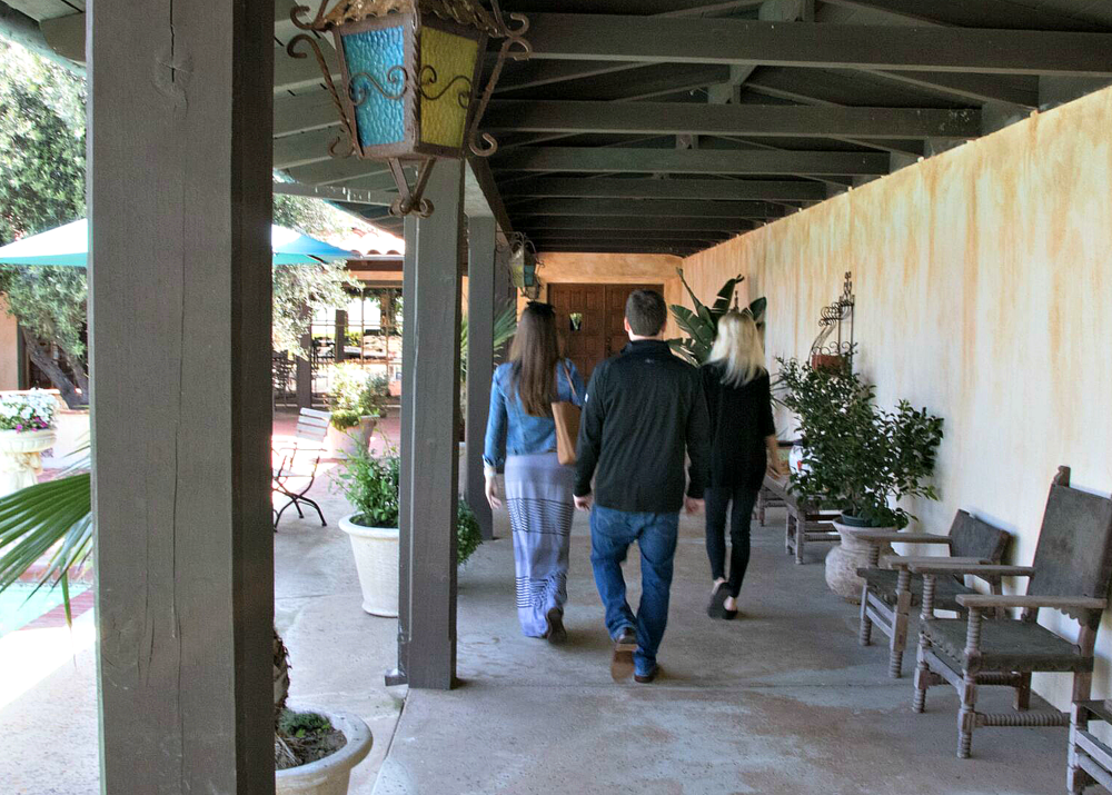 Walking through Roger and Claire's courtyard to their tasting room.