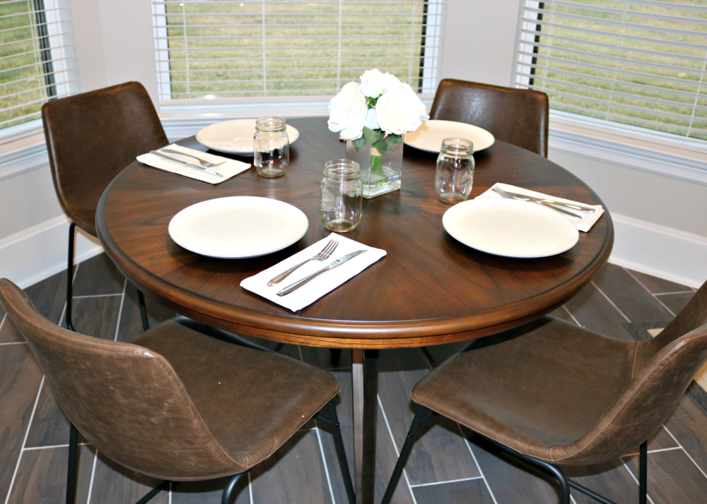 Ashley Furniture Wood and Metal Table with Leather Chairs